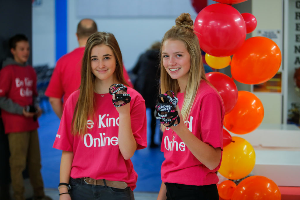 Two girls wearing Be Kind Online t-shirts at the 3rd annual IAS rally